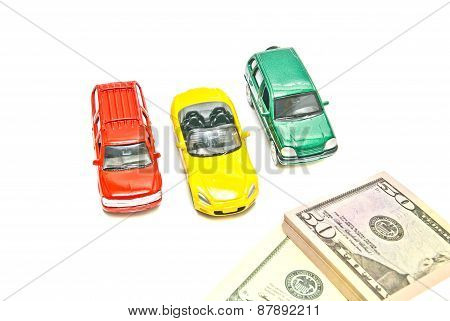 Three Cars And Dollar Notes On White
