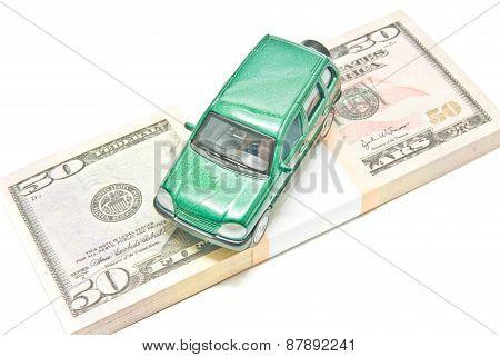 Green Car On Dollar Notes Closeup