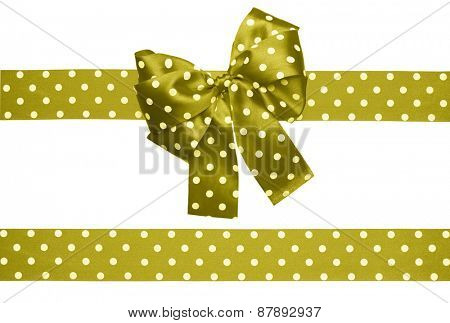 brown green bow and ribbon with white polka dots made from silk isolated