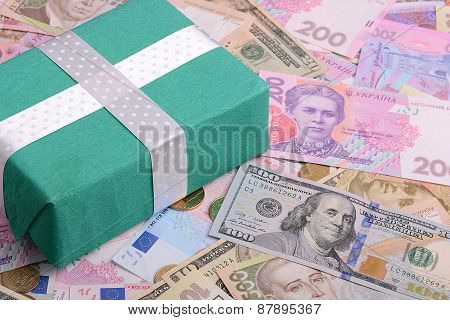 American And European Money Background And Green Gift Box