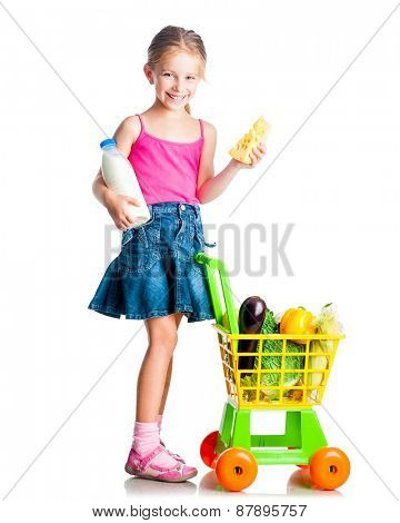 cute little girl with a basket from the supermarket keeps milk and cheese