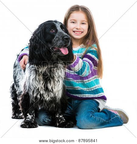 Happy cute little girl with her cocker spaniel puppy dog isolated on a white background
