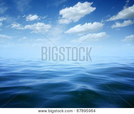 Blue sea water surface on sky