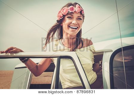 Hippie girl in a van on a road trip