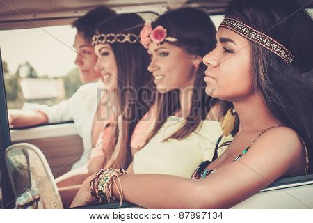 Multi-ethnic hippie friends on a road trip