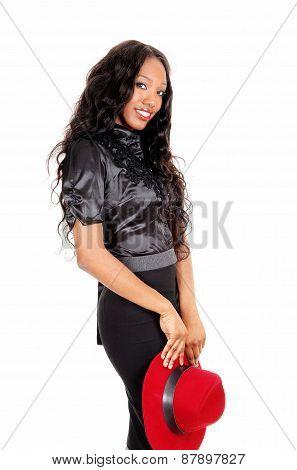 Pretty Black Woman Holding Hat.