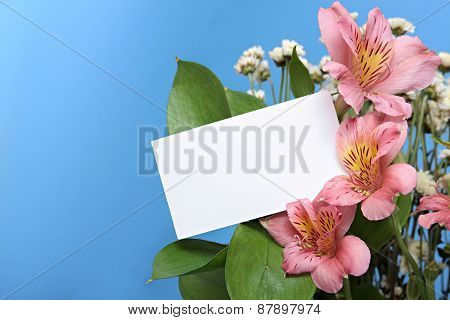 Bouquet of flowers with blank gift card