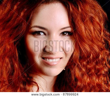 Beautiful young redhead woman with perfect daytime makeup smiling playfully