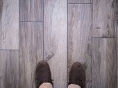 stock photo of tile cladding  - Walking on floor tiles with wood effect - JPG