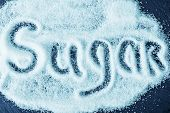 pic of sugar  - text on white sugar sugar on the table - JPG