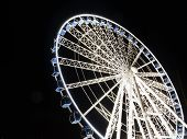 foto of observed  - Ferris observation wheel in Poland Gdansk Old Town night view - JPG
