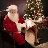Santa Pointing At Wish List