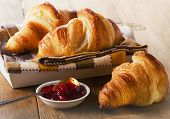stock photo of croissant  - Fresh Croissants on wooden background  - JPG