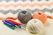 stock photo of knitting  - rolls of soft knitting yarn knitting on white background - JPG