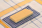 picture of section  - wafer and napkin in a section on a cloth in a section