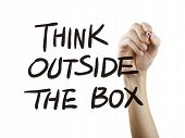 stock photo of thinking outside box  - think outside the box words written by hand on a transparent board - JPG