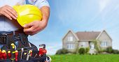 stock photo of handyman  - Builder handyman with construction tools - JPG