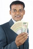 foto of indian currency  - Portrait of Indian business man holding indian money - JPG