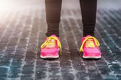 foto of rainy weather  - Unrecognizable young woman running in rainy weather - JPG