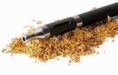 stock photo of electronic cigarette  - electronic cigarette in a bed of loose tobacco isolated on white - JPG