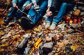 foto of tramp  - couple camping in the autumn forest - JPG