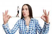pic of blindfolded man  - amazed woman looking at small woman with blindfold on the rope - JPG
