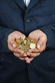 pic of indian money  - Business man Holding Indian Gold Coins in Hands - JPG