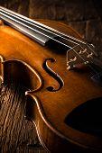 image of mozart  - violin in vintage style on wood background - JPG
