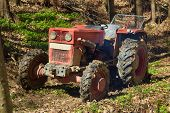 stock photo of logging truck  - Logging tractor with an anchor winch in the forest - JPG