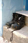 stock photo of work boots  - Work boots of painter on the stairs - JPG
