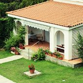 picture of red roof tile  - Beautiful white house with red tile roof small terrace and lawn in the garden - JPG