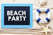 pic of starfish  - Beach party Text written on blackboard with starfish - JPG