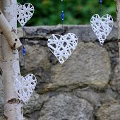 image of stall  - White handmade hearts for sale hanging at the craftsman - JPG