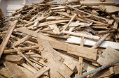 image of lumber  - Pile of old and dirty lumber in construction site - JPG