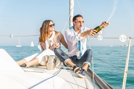 pic of boat  - Couple celebrating anniversary with champagne on a boat  - JPG