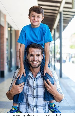 Portrait of a father and son piggybacking at the mall