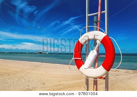 Lifebuoy, Life Preserver On Sandy Beach