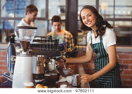 Portrait of a barista making a cup of coffee at the coffee shop