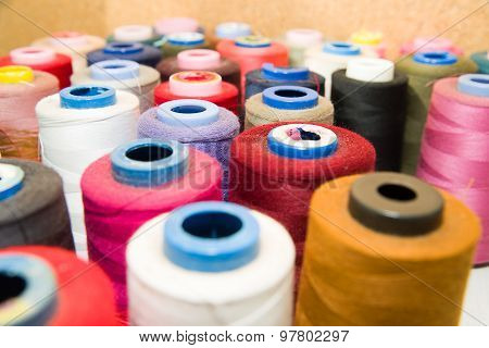 Many Reels Of  Threads Standing On The Table