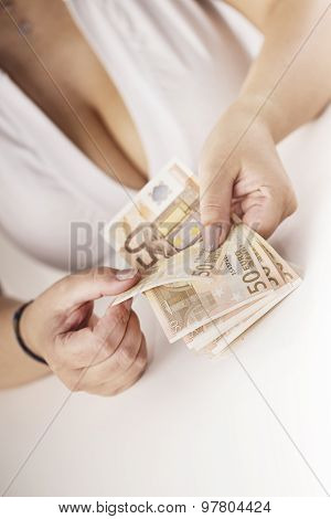 girl with large breasts playing with a banknote