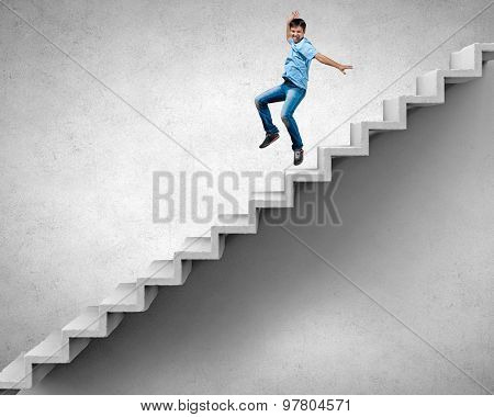Young man walking up on staircase representing success concept