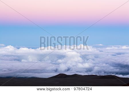 A classic pink inversion layer above a blue sky at 14,000 feet overlooking the top of the clouds.