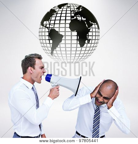 Businessman yelling with a megaphone at his colleague against grey background