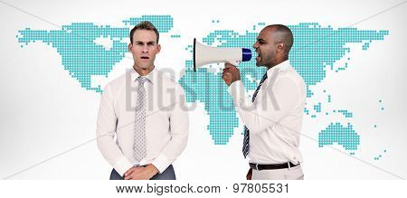Businessman yelling with a megaphone at his colleague against green world map on white background