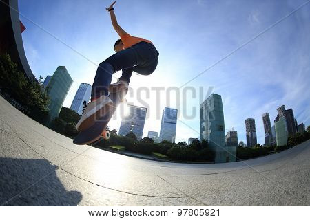 closeup of  skateboarder skateboarding at sunrise city