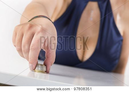 girl with large breasts playing with coins