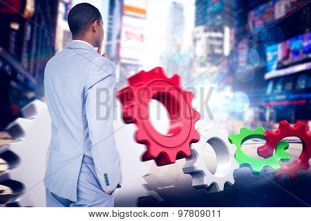 Thinking businessman against blurry new york street