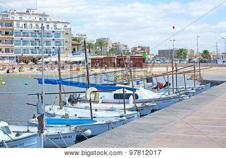 Moored Boats At Cala Estancia
