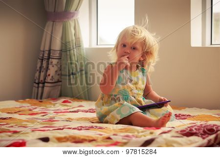 Blonde Girl Plays With Smartphone