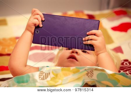 Blonde Girl Plays With Smartphone Closeup